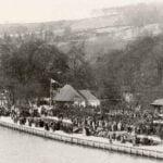Promenading crowd at Belper River Gardens with bandstand and Tea Rooms