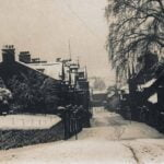 Snowy scene of King Street Belper with the Memorial Gardens on the left of the photo