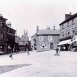 View of belper Market Place in the 1890s with St Peter's church in the background.